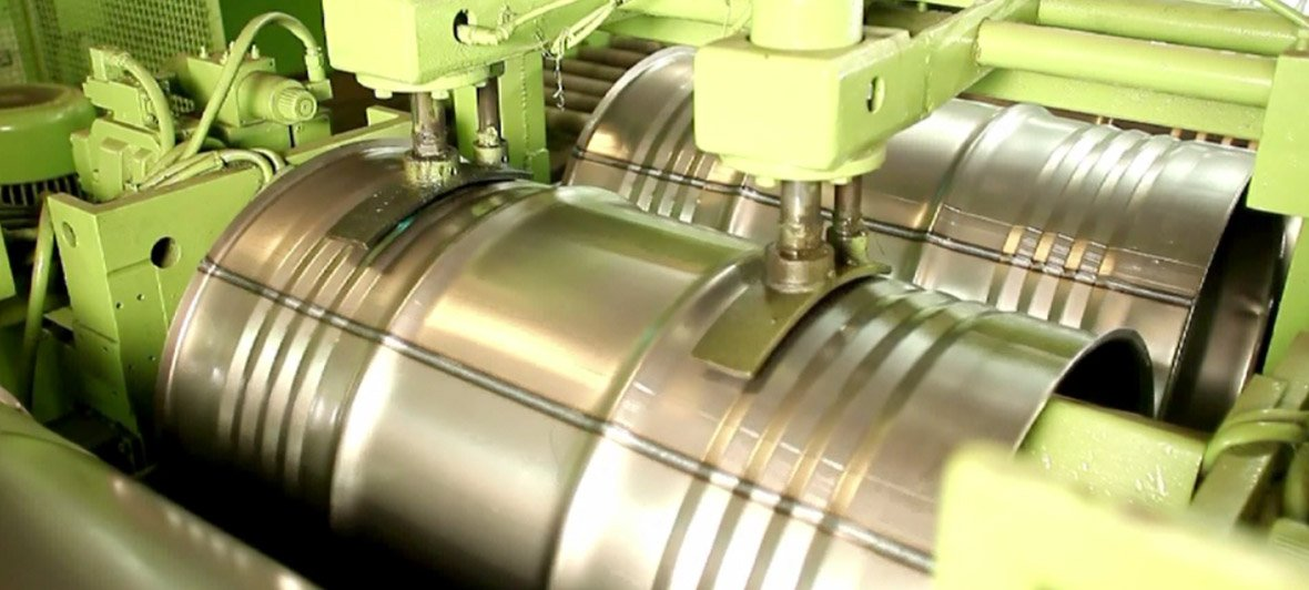 Industrial packaging – steel barrel being manufactured